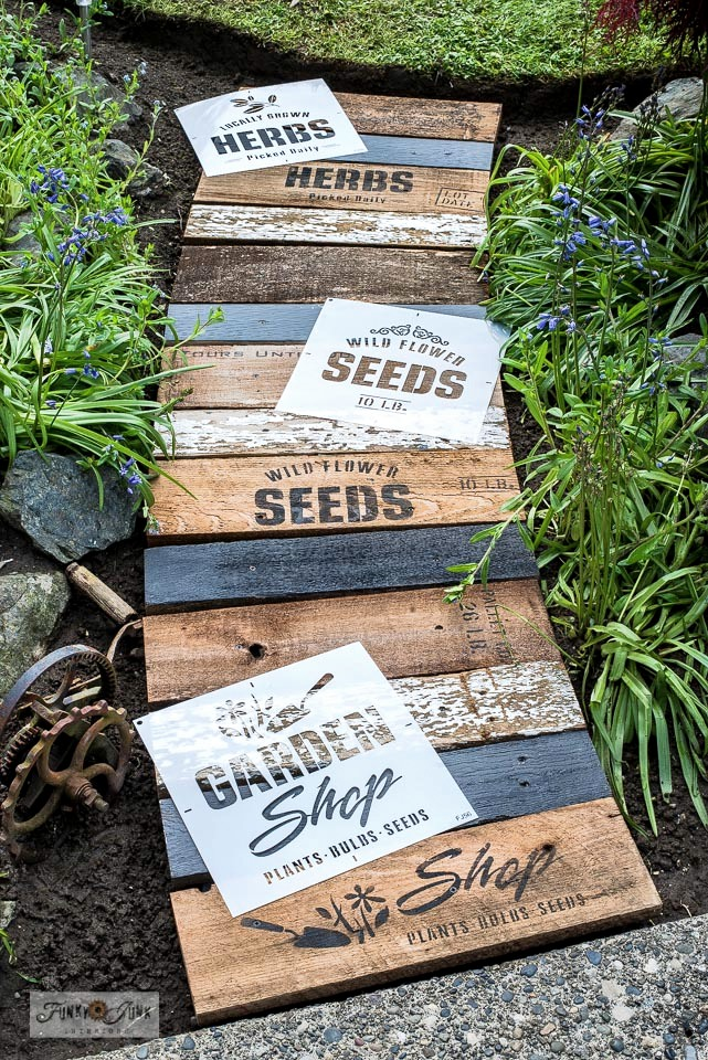 Learn how to build this easy and beautiful garden-themed reclaimed wood walkway with scrap wood and Funky Junk's Old Sign Stencils! Click for full tutorial and short video! #gardening #walkway #stencils #oldsignstencils #gardensigns