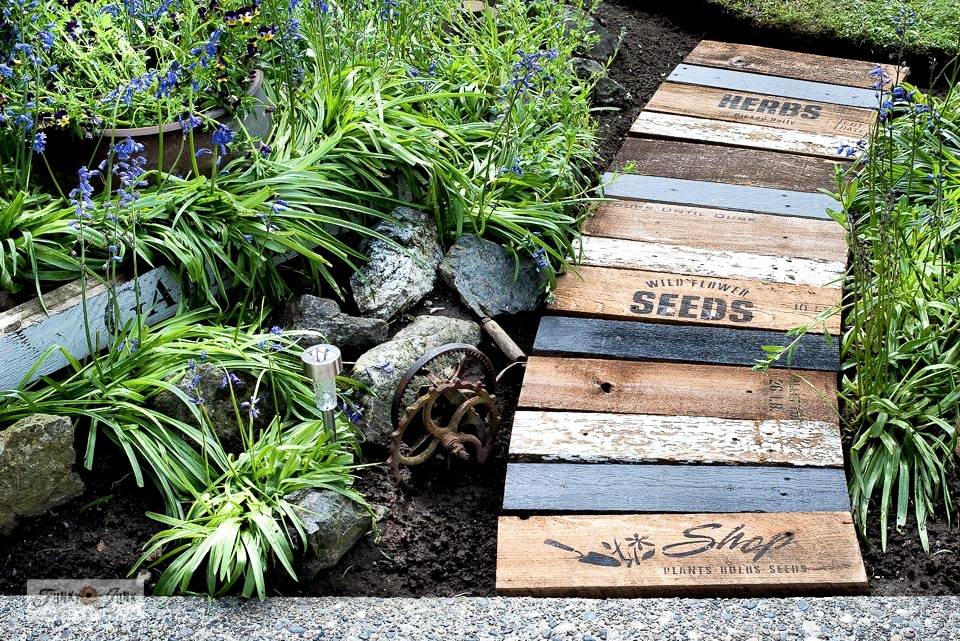 Learn how to build a garden-themed scrap wood walkway. #gardening #stencils #reclaimedwood #gardenwalkway