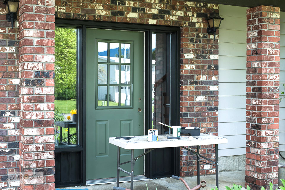 Learn how to repaint a front door black-ish brown using house trim paint! View tips and see the reveal of the front entry! #paintingtips #frontdoor #doorpaint