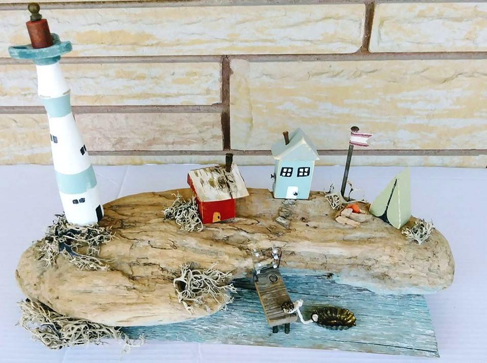 Scrap wood mini lighthouse village by Junky Encores on Facebook, featured on DIY Salvaged Junk Projects 527 on Funky Junk!