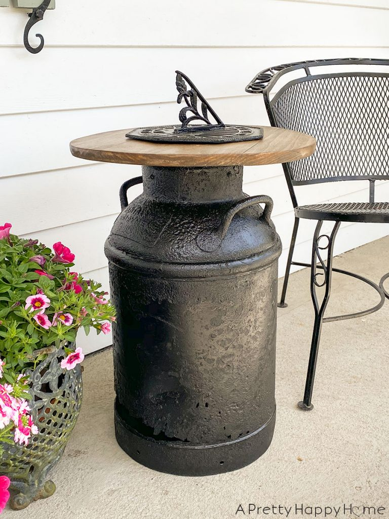 Sundial milk can side table by A Pretty Happy Home, featured on DIY Salvaged Junk Projects 529 on Funky Junk!