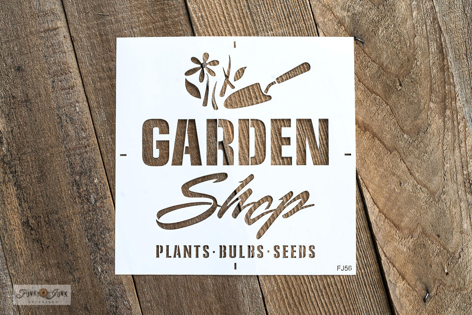 Garden Shop is a garden-themed stencil from the collection of Funky Junk's Old Sign Stencils. Click to view how Garden Shop was used to enhance a rustic garden shed gate! Full tutorial with video is included. #gardenshed #shed #stenciling