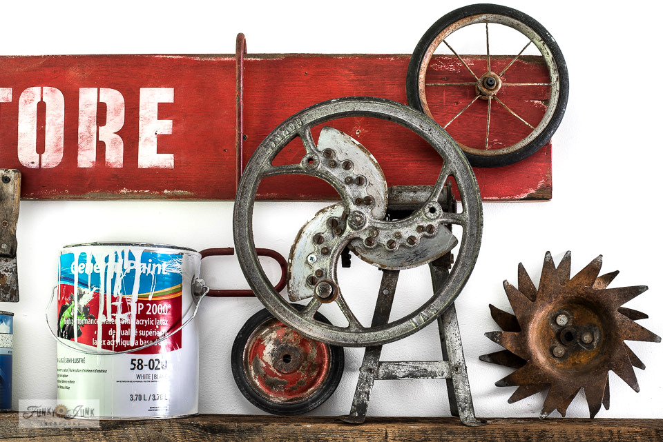 A collection of antique wheels lines the top shelf of a workshop cubby. Click to take the full tour and learn how to make a paint shelf from reclaimed wood! #workshop #storage #tools