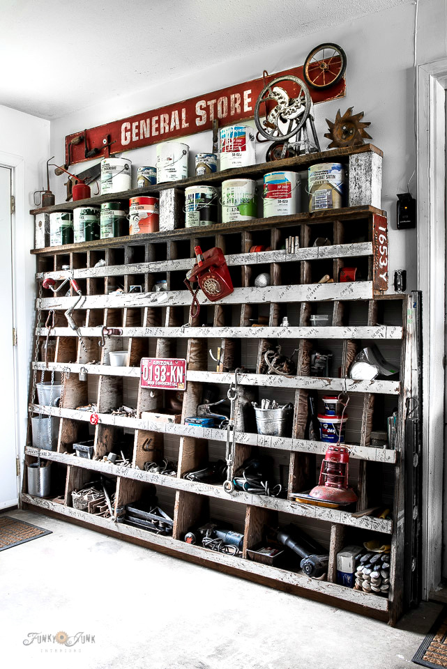 General Store junk-filled workshop cubby with paint shelf extension by Funky Junk Interiors