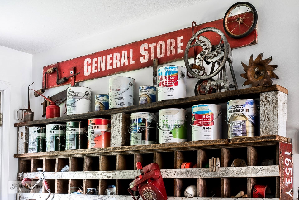 Need more space in the workshop for tools and such? Here's how I'm organizing my workshop with a unique stenciled General Store storage cubby and reclaimed wood paint shelf extension! Click to view the full tour and learn how to make the paint shelf. #workshop #storage #organize #tools