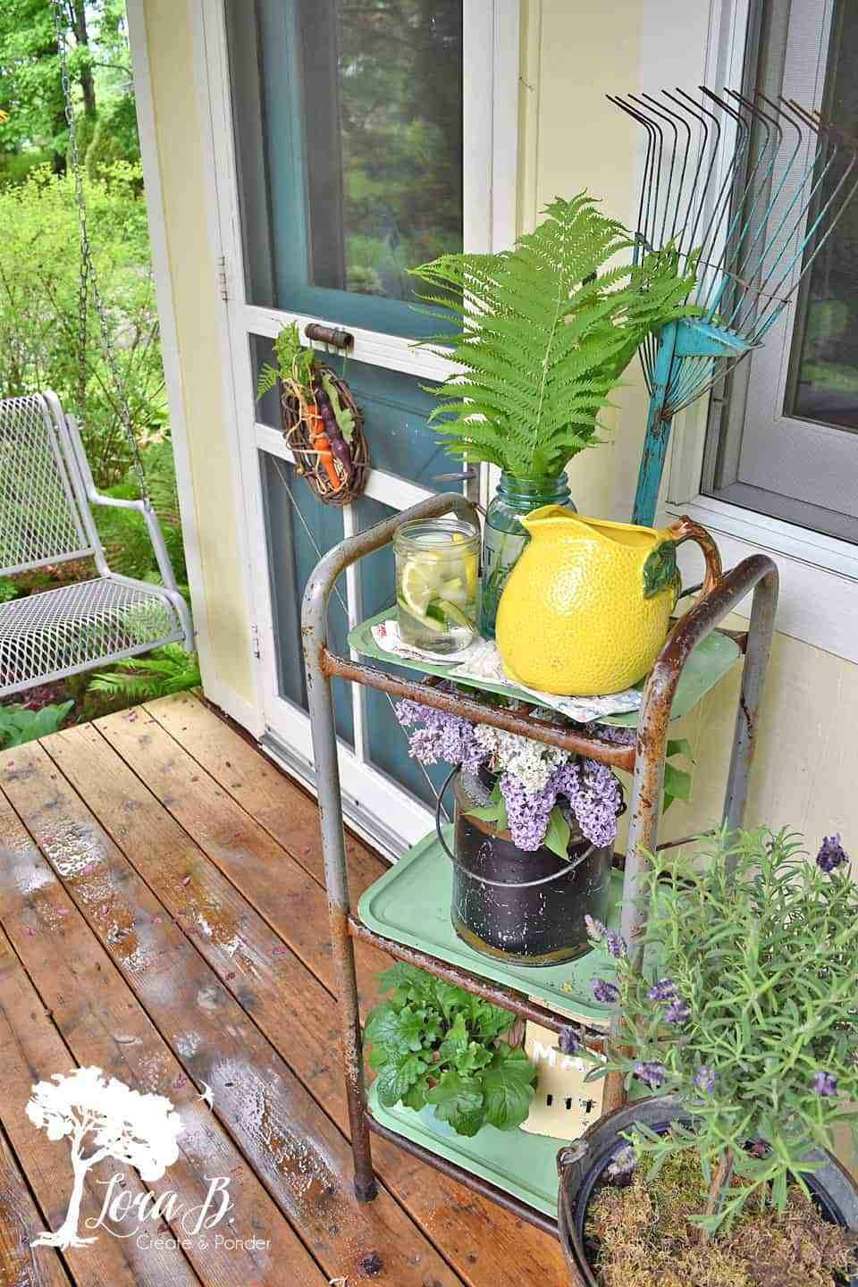 A vintage summer porch tour by Lora B, featured on DIY Salvaged Junk Projects 530 on Funky Junk!