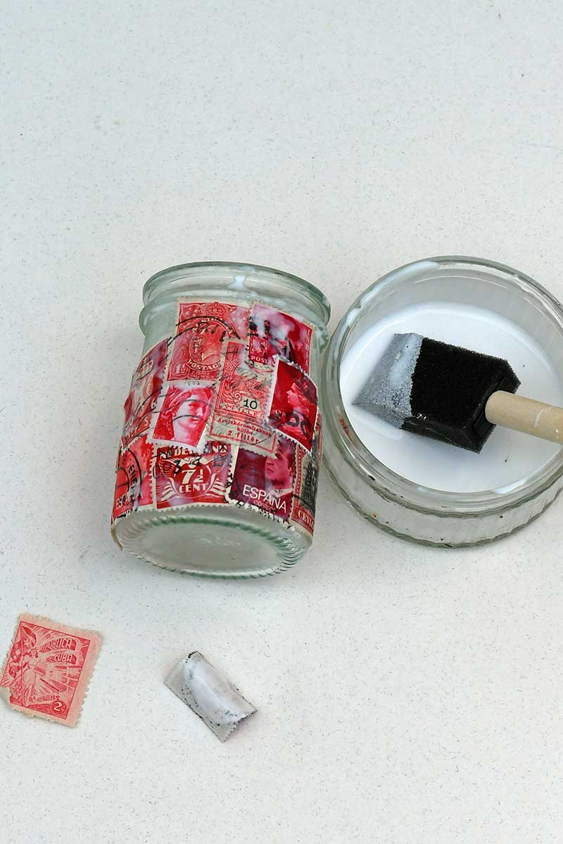 Postage stamp tea light jars by Pillar Box Blue, featured on DIY Salvaged Junk Projects 531 on Funky Junk!