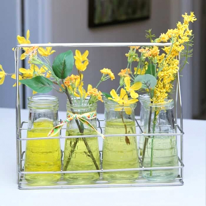 Urine specimen bottle flower flower vases by Petticoat Junktion, featured on DIY Salvaged Junk Projects 531 on Funky Junk!