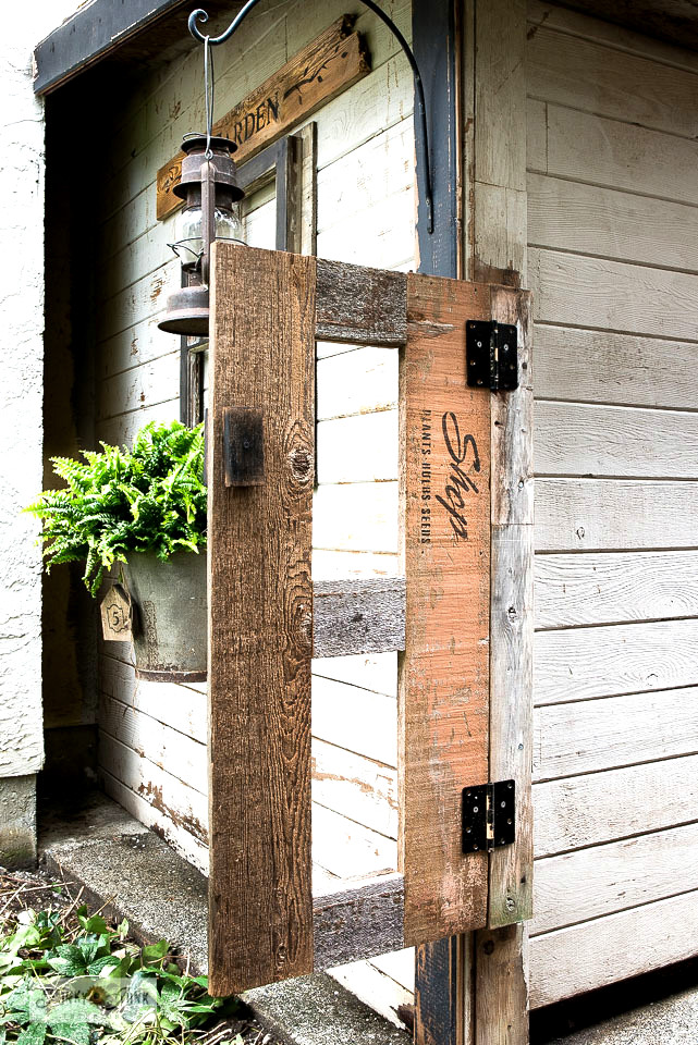 Easy rustic garden-themed shed gate by Funky Junk Interiors, featured on DIY Salvaged Junk Projects 533 on Funky Junk!
