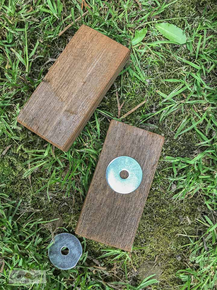 How to make simple locking blocks for a rustic garden gate using reclaimed wood and a washer. Click for full garden gate tutorial.