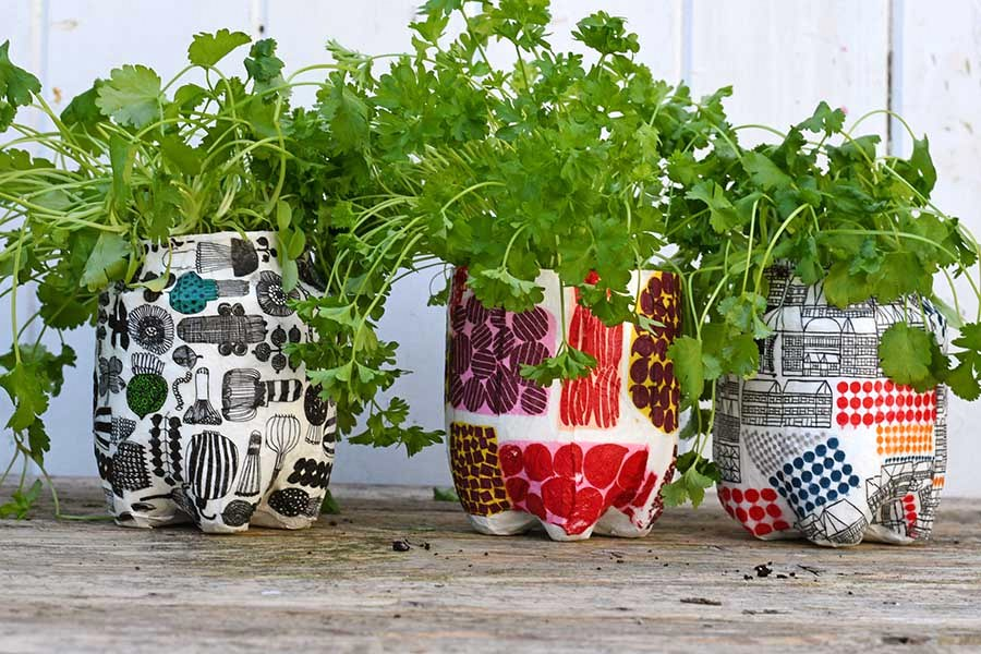 Plastic bottle marimekko planters by Pillar Box Blue, featured on DIY Salvaged Junk Projects 530 on Funky Junk!