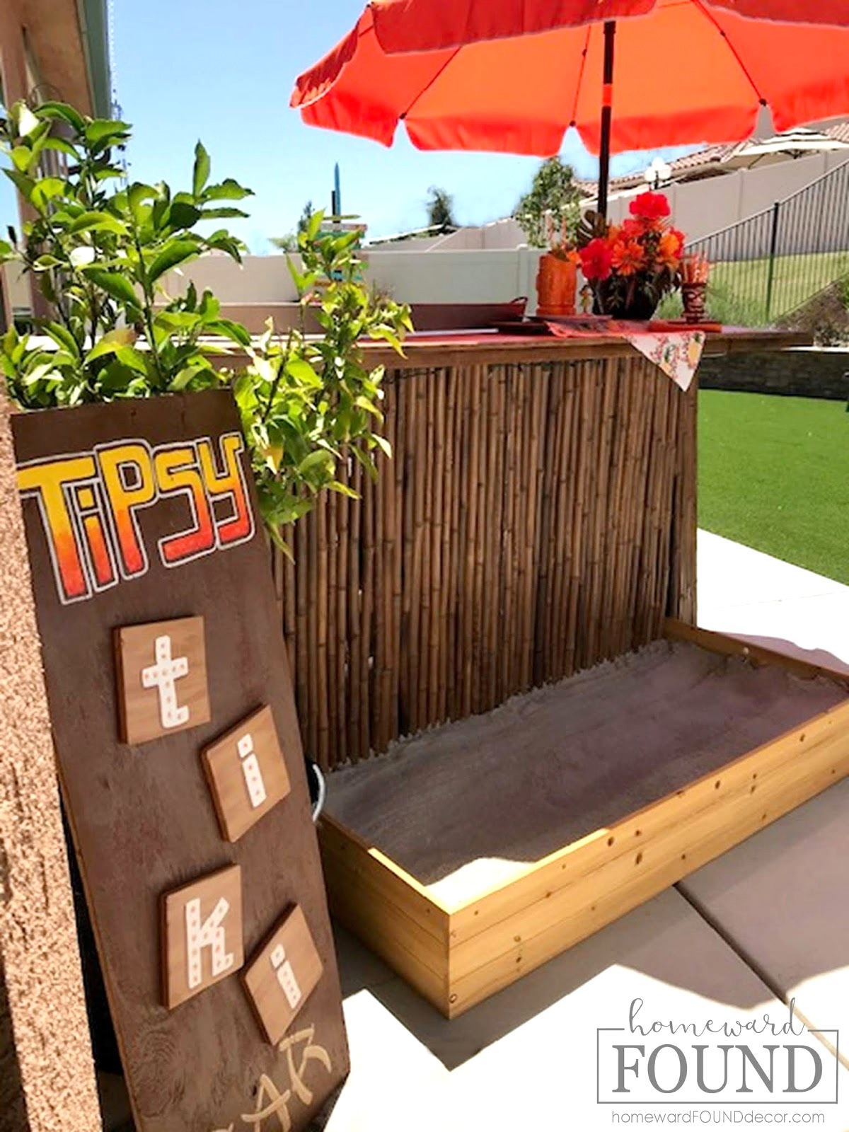 Backyard tiki bar with sandbox by Homeward Found, featured on DIY Salvaged Junk Projects 530 on Funky Junk!