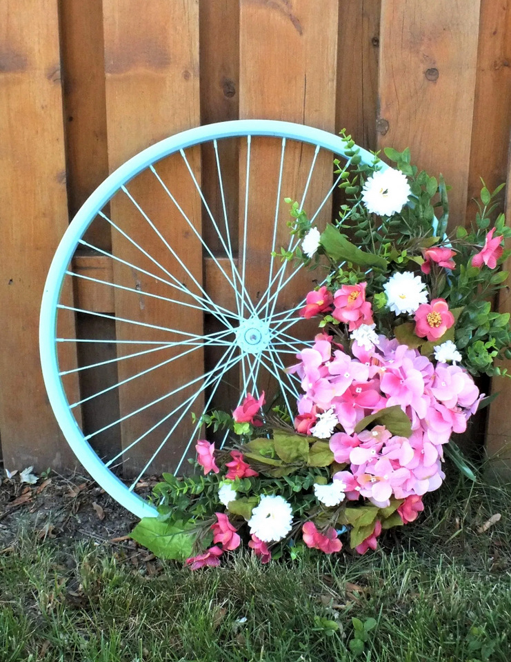 Bike wheel summer flower wreath by Simply Chic Treasures, featured on DIY Salvaged Junk Projects 534 on Funky Junk!