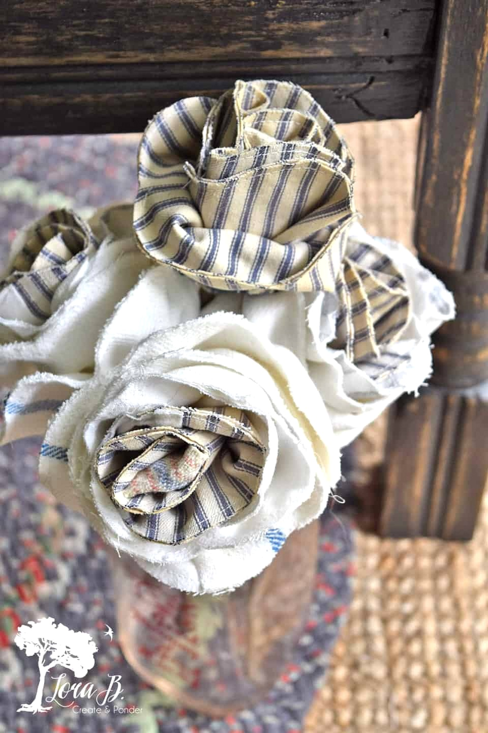 Fabric ticking farmhouse flowers by Lora B, featured on DIY Salvaged Junk Projects 536 on Funky Junk!