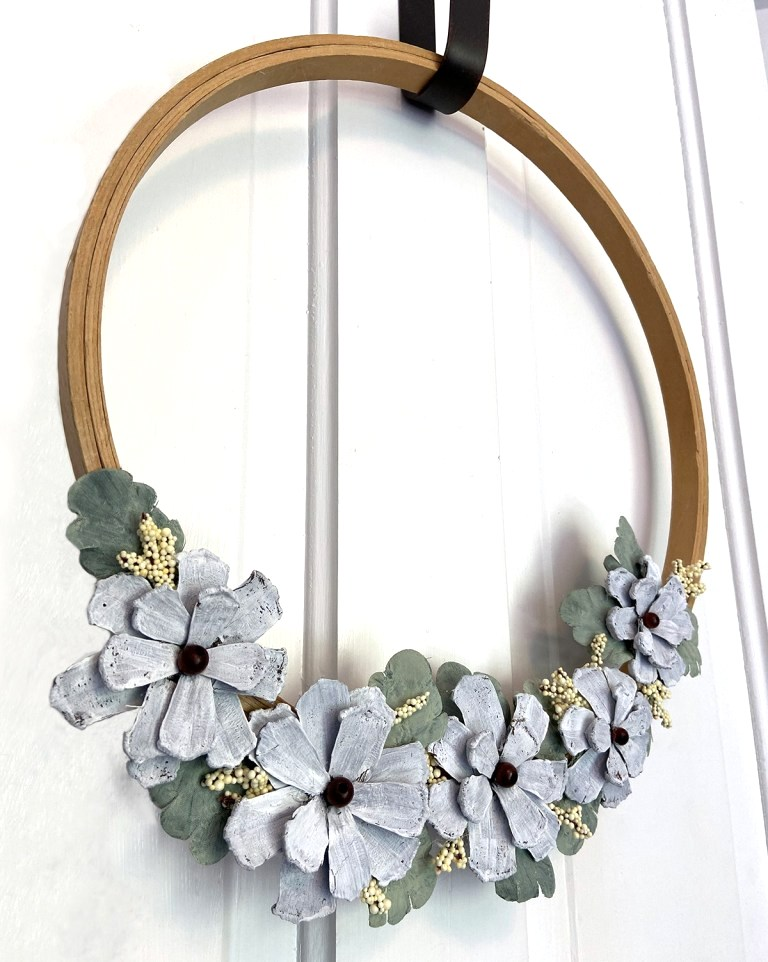 Flower pinecone wreath by Wisconsin Magpie, featured on DIY Salvaged Junk Projects 537 on Funky Junk!