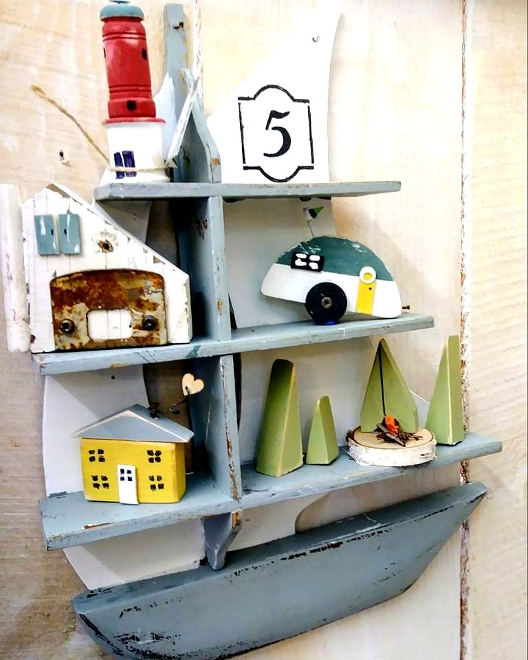 Sail boat shelf filled with junk houses by Junky Encores, featured on DIY Salvaged Junk Projects 534 on Funky Junk!