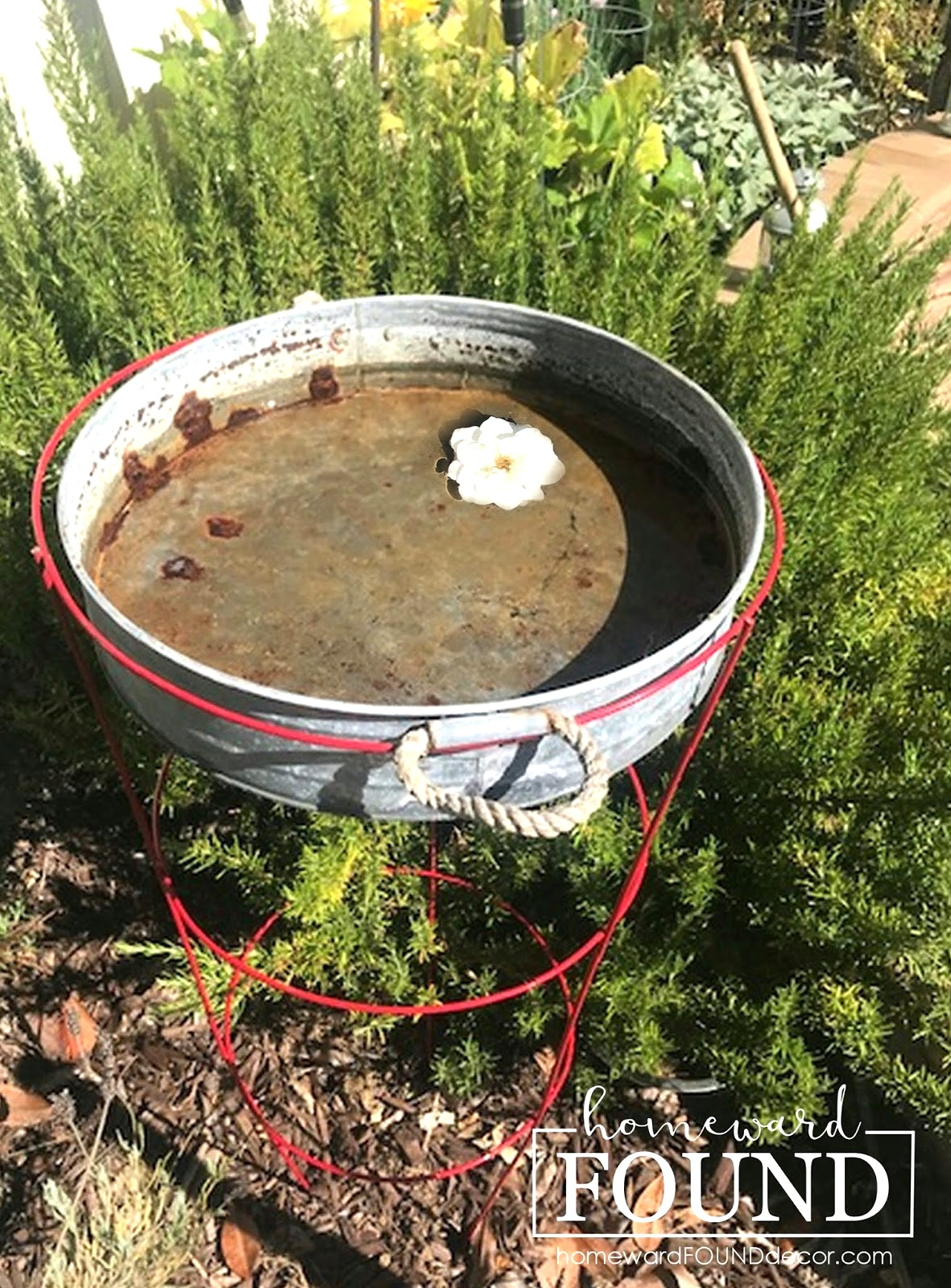 Tub and tomato cage birdbath by Homeward Found, featured on DIY Salvaged Junk Projects 537 on Funky Junk!