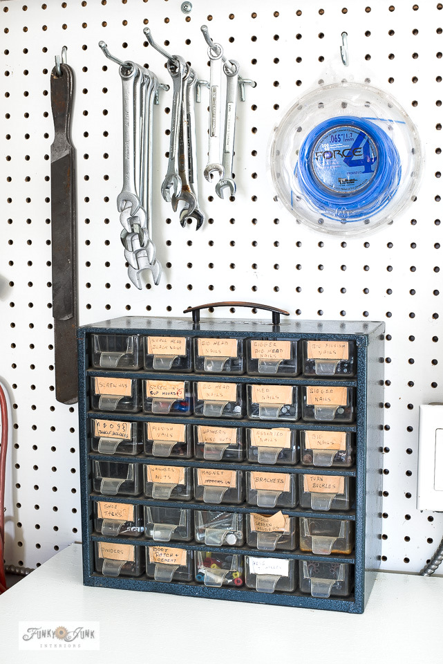 An antique tool organizer with hand written labels. A sweet reminder of the past while organizing the workshop!