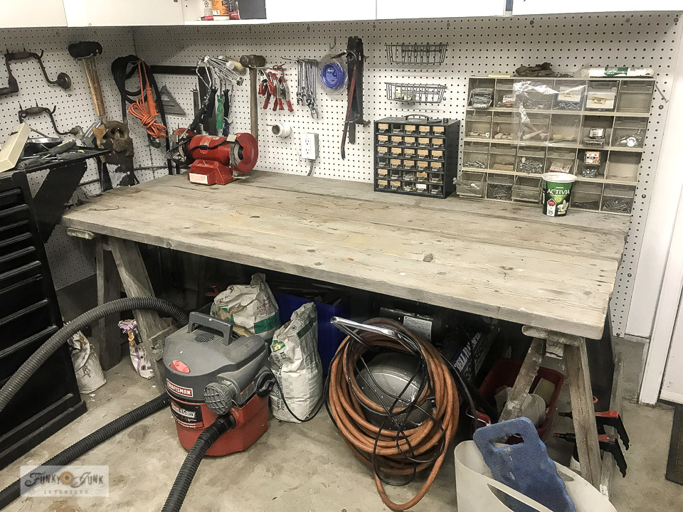 A messy workshop table before. Visit this post to view the outstanding after, using an old door as a workshop table top!