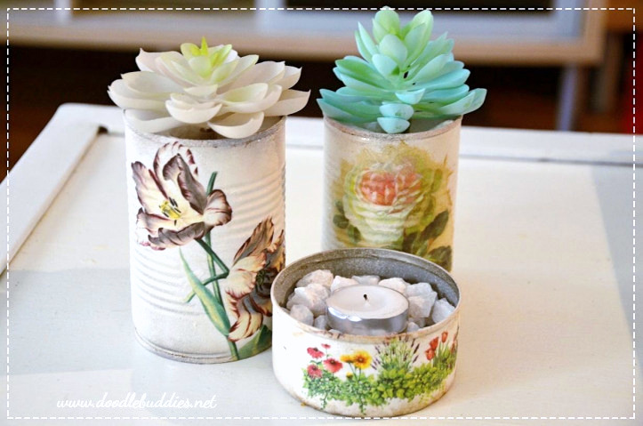 Decoupaged tin can vases by Doodle Buddies, featured on DIY Salvaged Junk Projects 540 on Funky Junk!