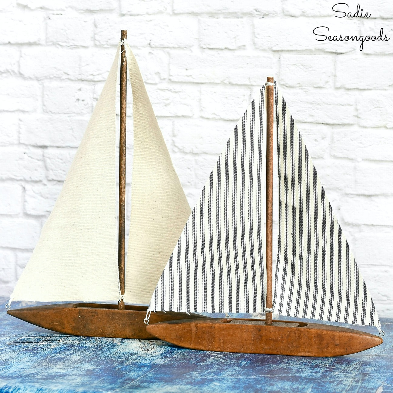 Upcycled weaving shuttle sailboats by Sadie Seasongoods, featured on DIY Salvaged Junk Projects 539 on Funky Junk!