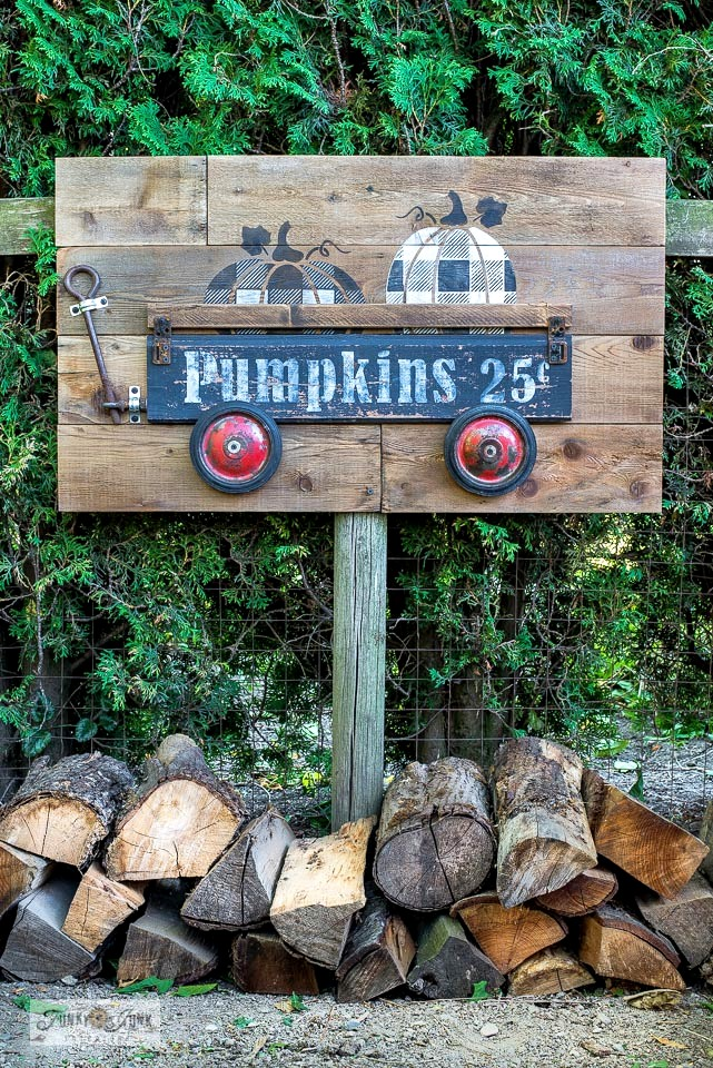Learn how to create this charming rustic Fall Buffalo Check pumpkins in wagon sign using reclaimed wood, wheels, rusty junk and stencils by Funky Junk's Old Sign Stencils! Click to full tutorial, including helpful videos!