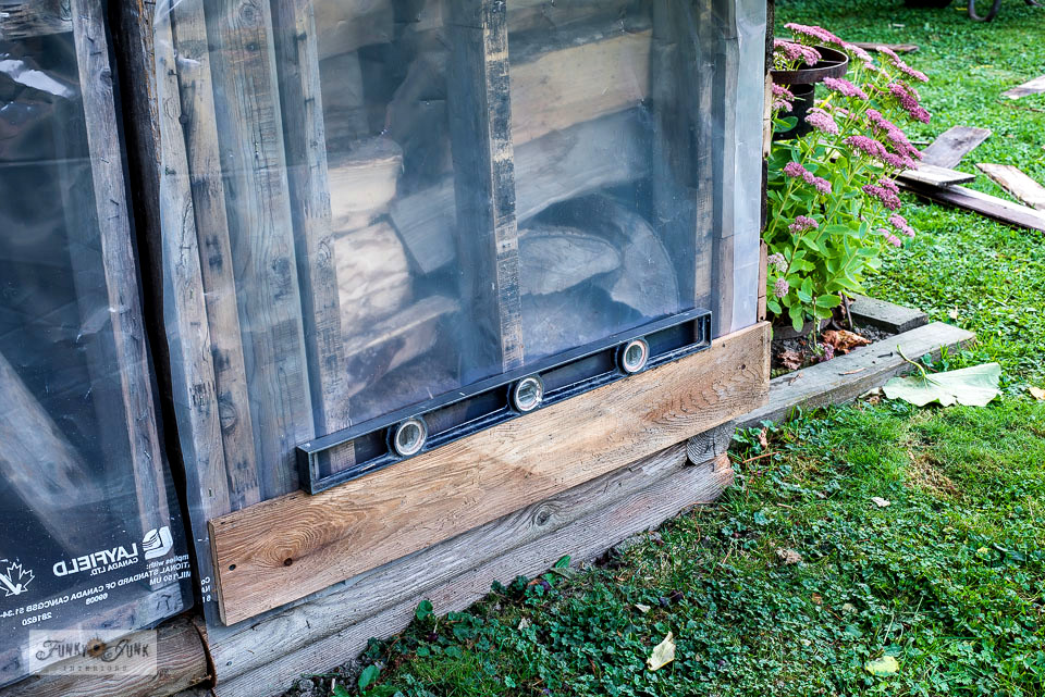 Building a shed? Here's how installing reclaimed wood shed siding with a shingled gable made this garden shed so rustic and quaint! Click to full tutorial to learn more.
