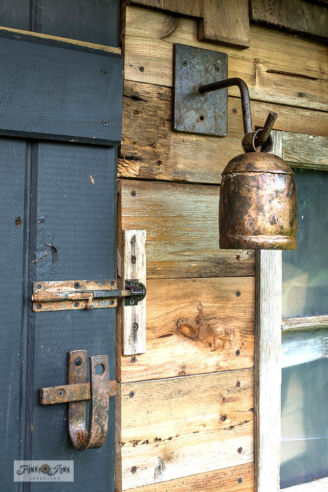 See how rusty junk hardware was added to a shed barn door for loaded antique character!