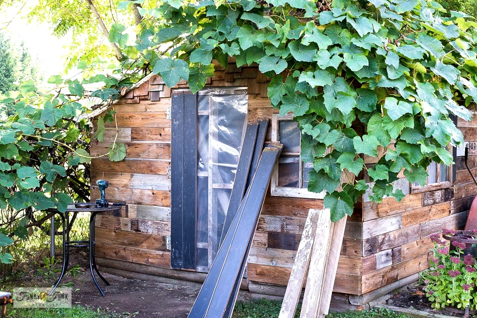 How to build a barn door for a rustic garden shed. Click to full tutorial.