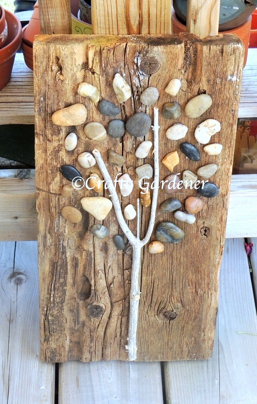 Stone and twig tree art by Crafty Gardener, featured on DIY Salvaged Junk Projects 545 on Funky Junk!