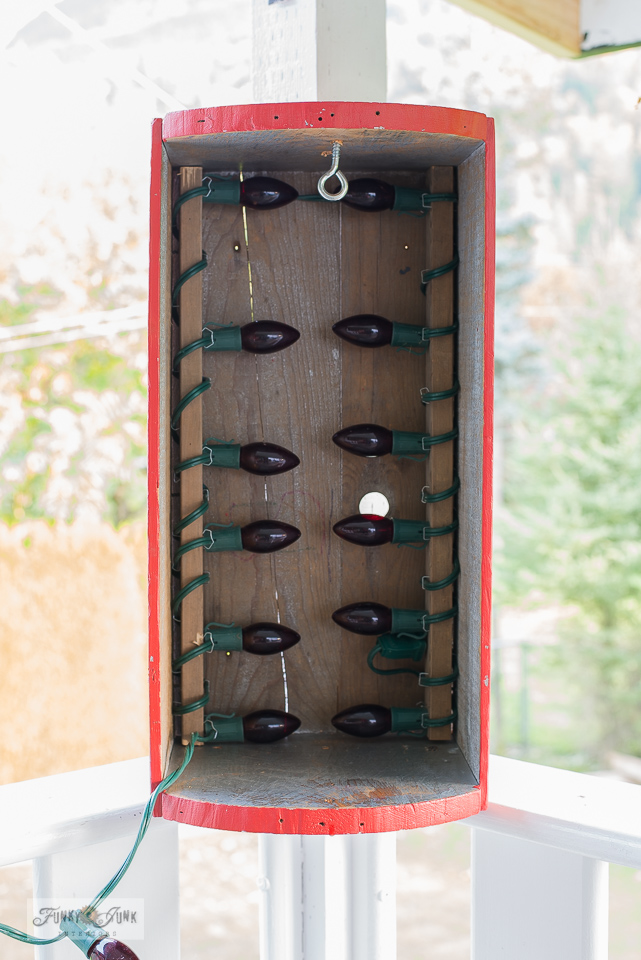 Learn how to make a Buffalo Checked DIY Hummingbird feeder heater crate using red Christmas lights to keep nectar from freezing during winter! Click to view helpful video and full tutorial!