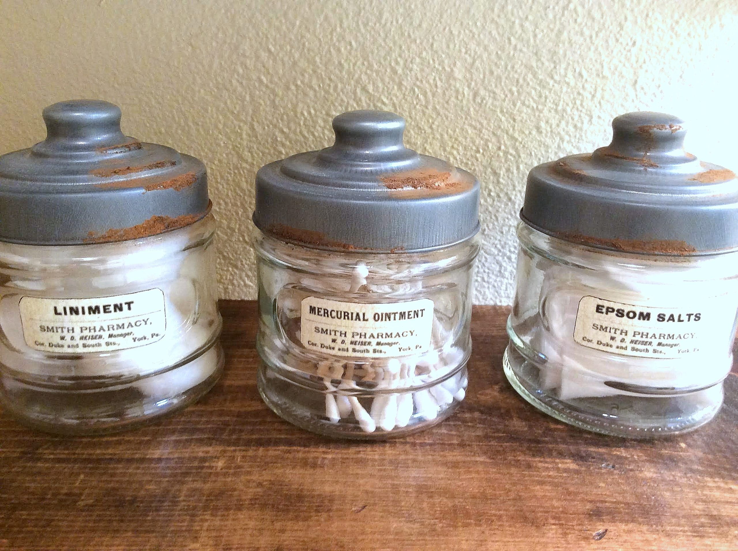 Creating rusty lids by Fresh Vintage By Lisa S, featured on DIY Salvaged Junk Projects 547 on Funky Junk!