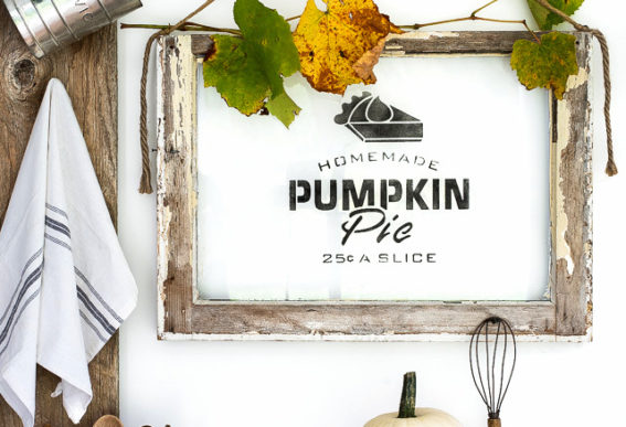 Homemade Pumpkin Pie sign on an old window with stencils