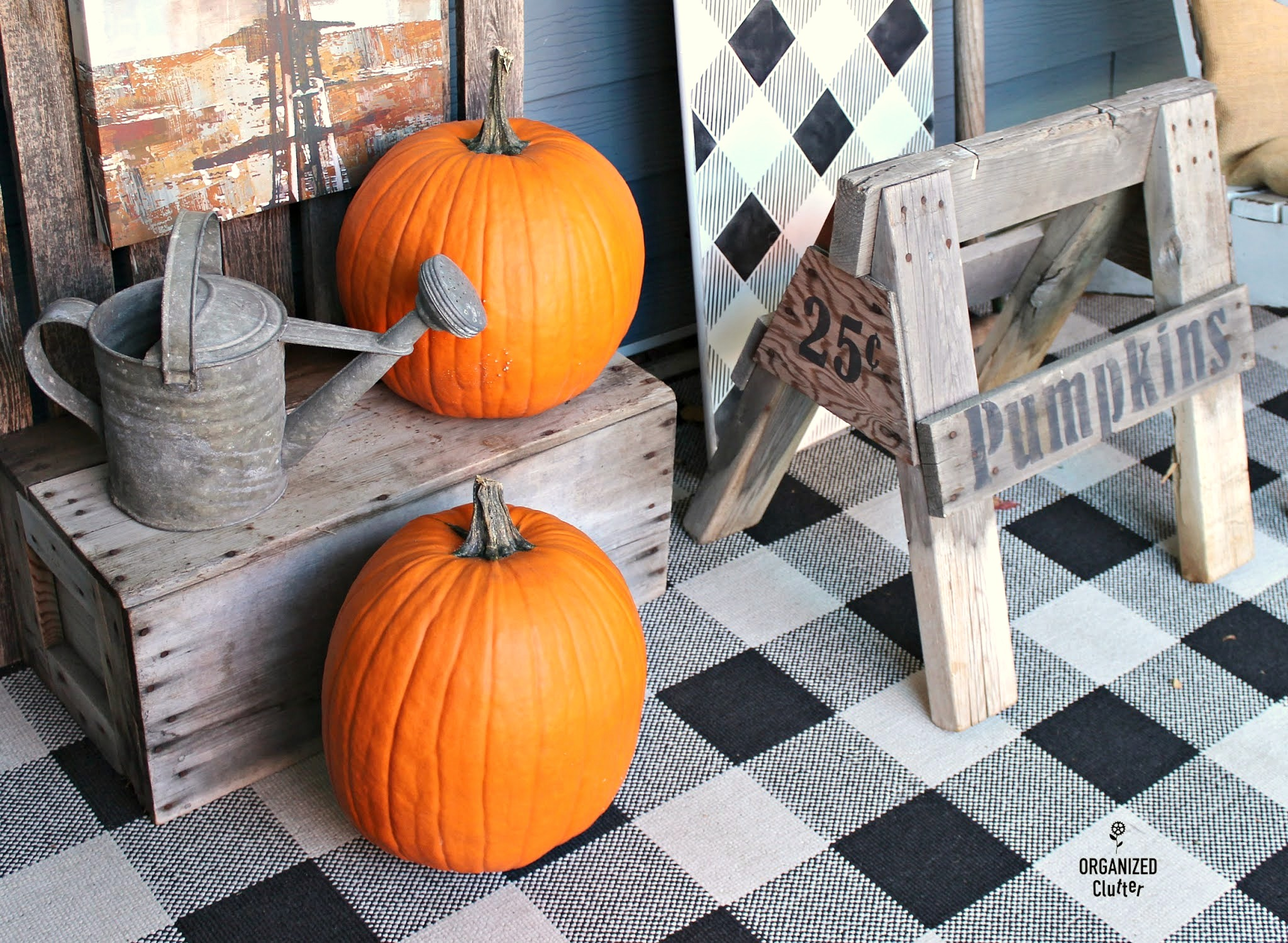 Sawhorse pumpkin sign fall porch by Organized Clutter, featured on DIY Salvaged Junk Projects 549 on Funky Junk!