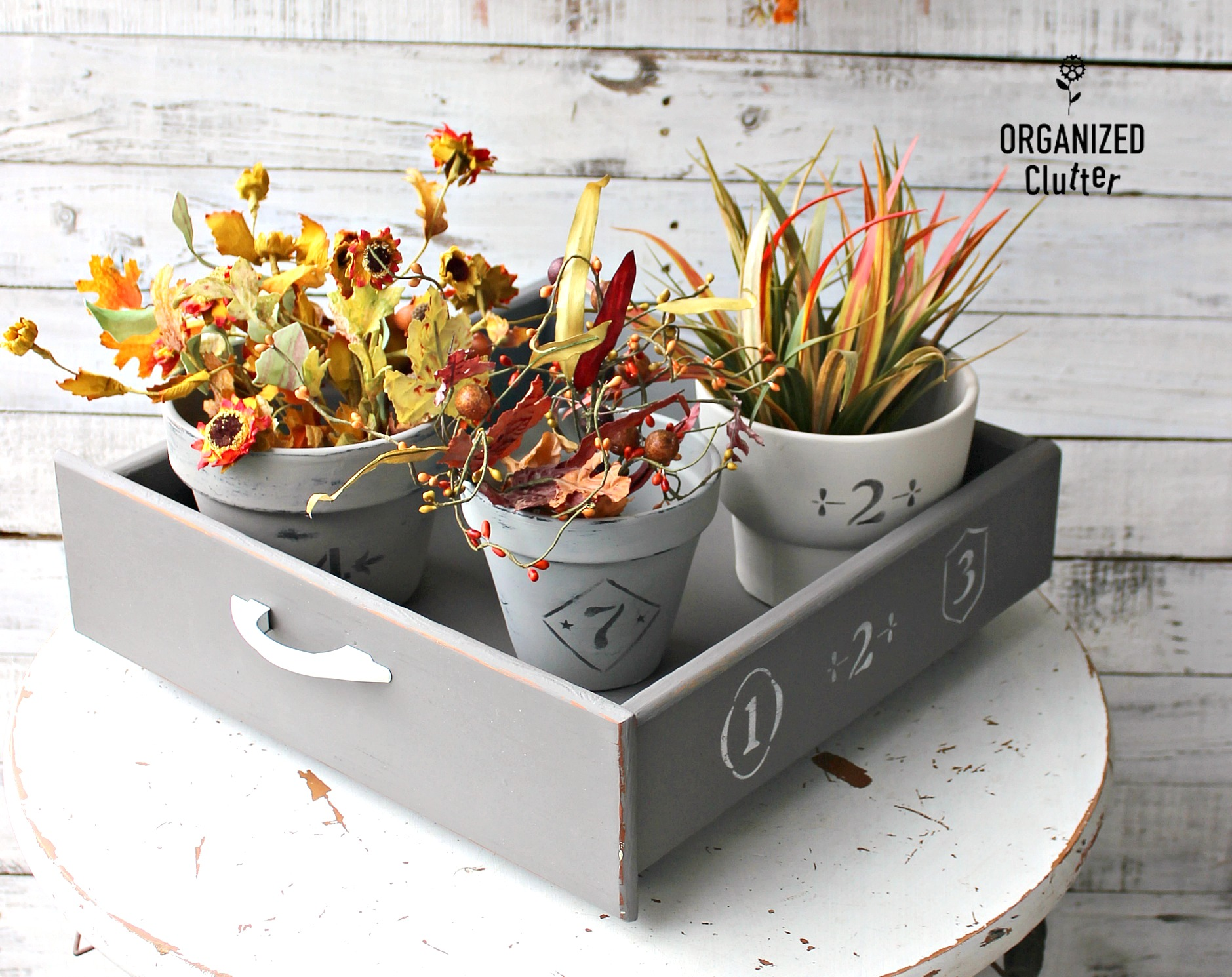 Vintage crock clay pots fall vignette by Organized Clutter, featured on DIY Salvaged Junk Projects 551 on Funky Junk!