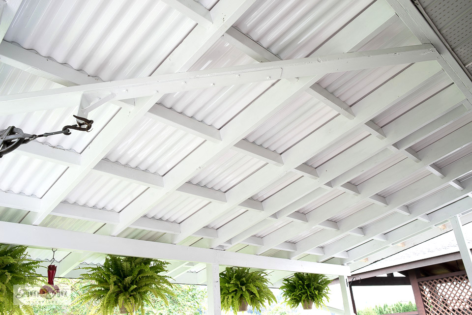 Need a new affordable porch roof? Learn tips on replacing a pvc patio roof for a beautiful bright white plantation look! Includes pros, cons and info on pvc vs. polycarbonate, and what NOT to do! Click to read the full tutorial.