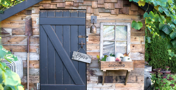 rustic fall shed with crate windowbox and directional signs