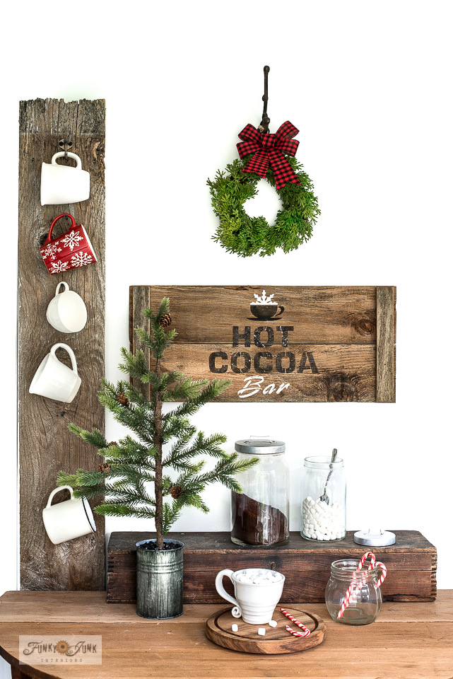 Learn how to create this charming and compact rustic crate-styled Hot Cocoa Christmas wood sign with reclaimed wood and Funky Junk's Old Sign Stencils! Complete with marshmallow lettering! Perfect for Christmas decorating! Visit to full tutorial.