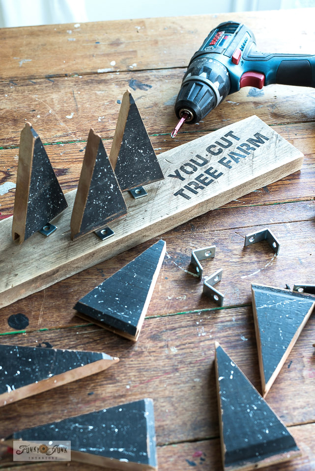 Learn how to make this charming Christmas scrap wood tree farm using reclaimed wood and Christmas tree and pattern stencils from Funky Junk's Old Sign Stencils! Such an easy, rustic Christmas decorating idea! Click to read full tutorial!