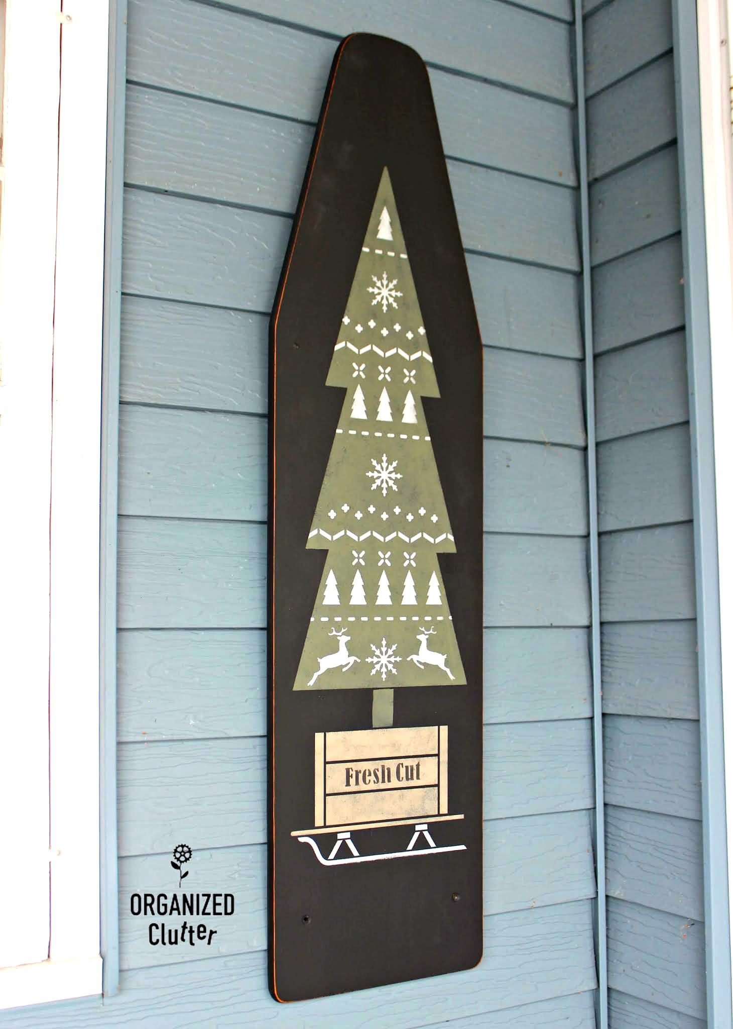 Stenciled Christmas tree on ironing board by Organized Clutter, featured on DIY Salvaged Junk Projects 555 on Funky Junk!