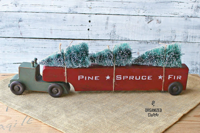 Toy Christmas tree hauling truck by Organized Clutter, featured on DIY Salvaged Junk Projects 554 on Funky Junk!