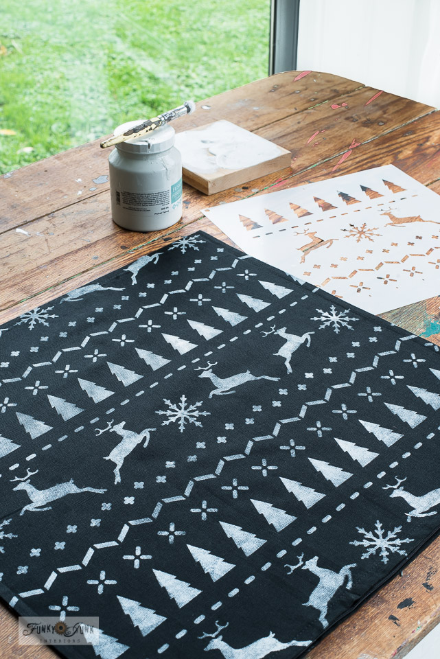 Learn how to stencil these charming black and white DIY Christmas Sweater pillows using stencils and Ikea pillow covers! Quick and easy, perfect for Christmas or winter decorating! Click to read full tutorial and watch helpful video how-to! #funkyjunksoldsignstencils