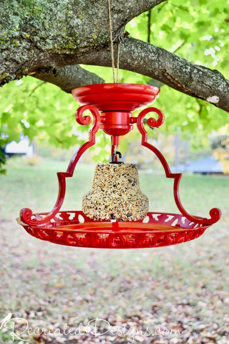 Light fixture bird feeder by Recreated Designs, featured on DIY Salvaged Junk Projects 552 on Funky Junk!