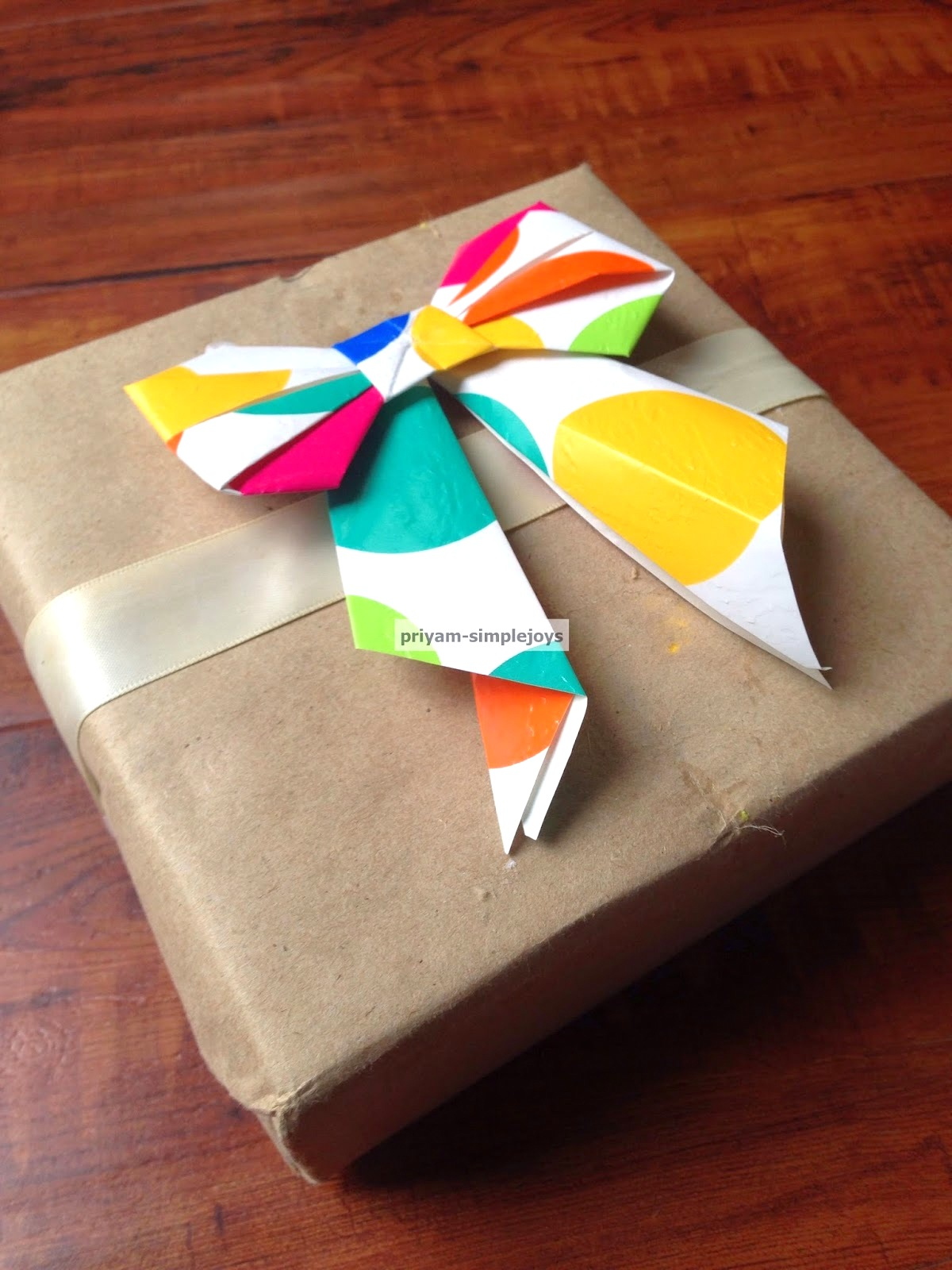 Paper bow by Simple Joys, featured on DIY Salvaged Junk Projects 552 on Funky Junk!