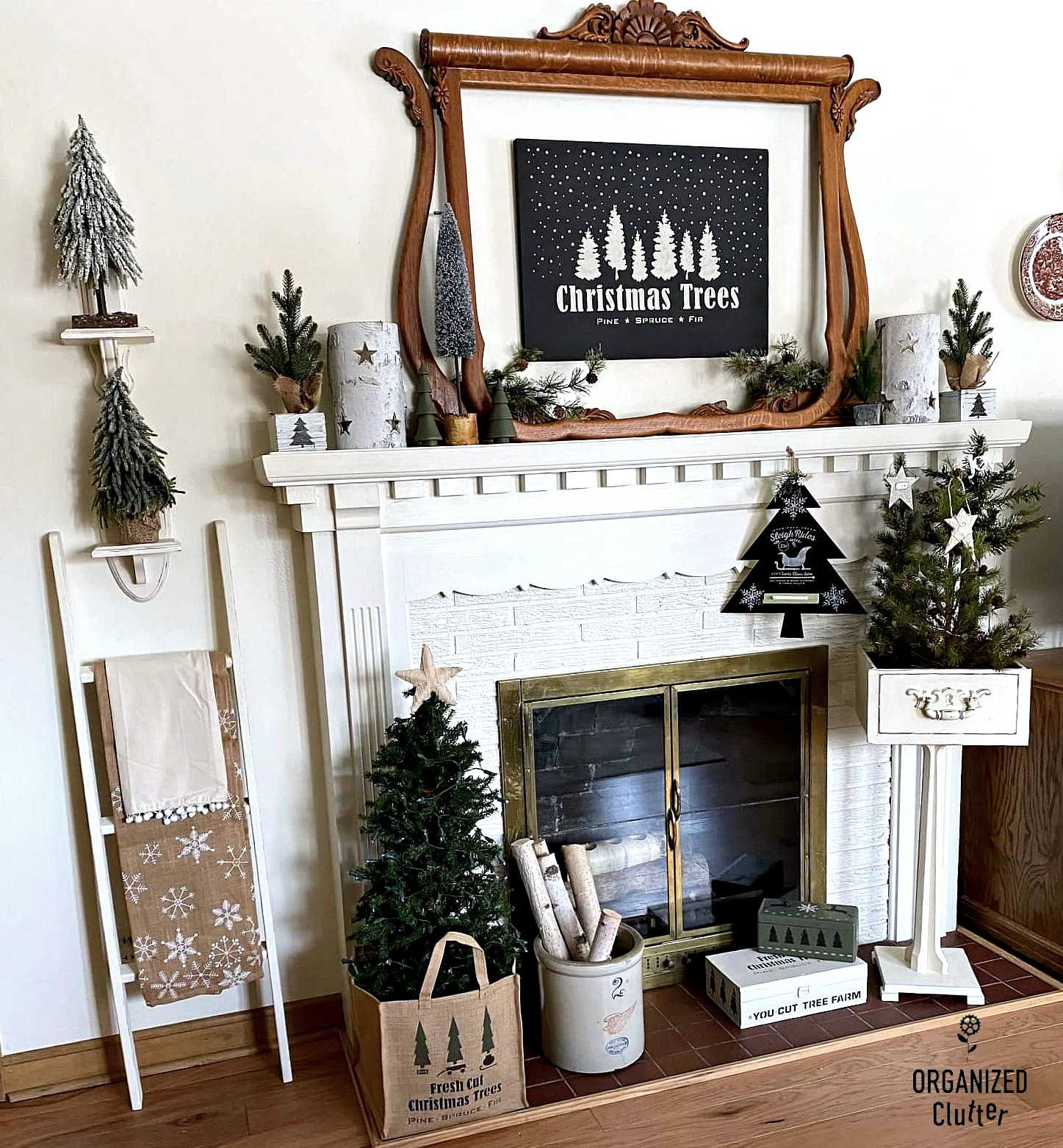 Neutral Christmas fireplace mantel with signs decor by Organized Clutter, featured on DIY Salvaged Junk Projects 558 on Funky Junk!