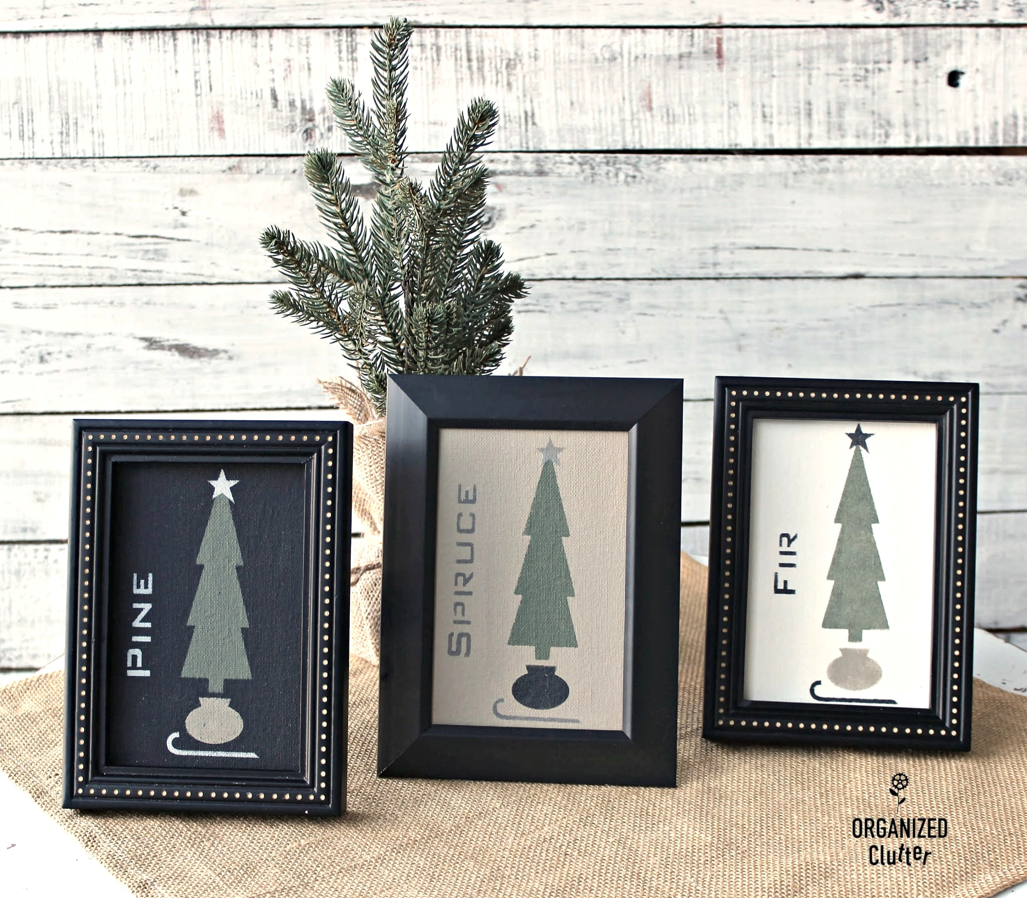 Christmas tree stenciled art by Organized Clutter, featured on DIY Salvaged Junk Projects 558 on Funky Junk!