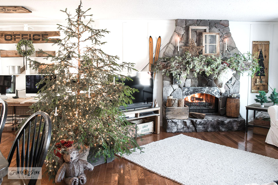 Natural Christmas tree in Christmas living room home tour. Click to tutorials and full tour!