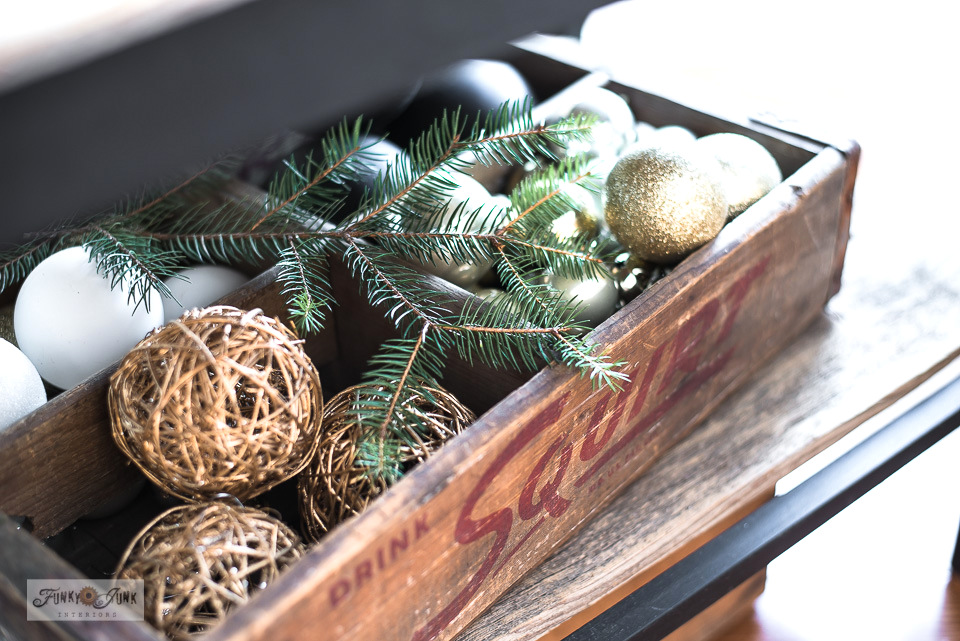 Ornaments inside a vintage crate in a Christmas living room home tour.