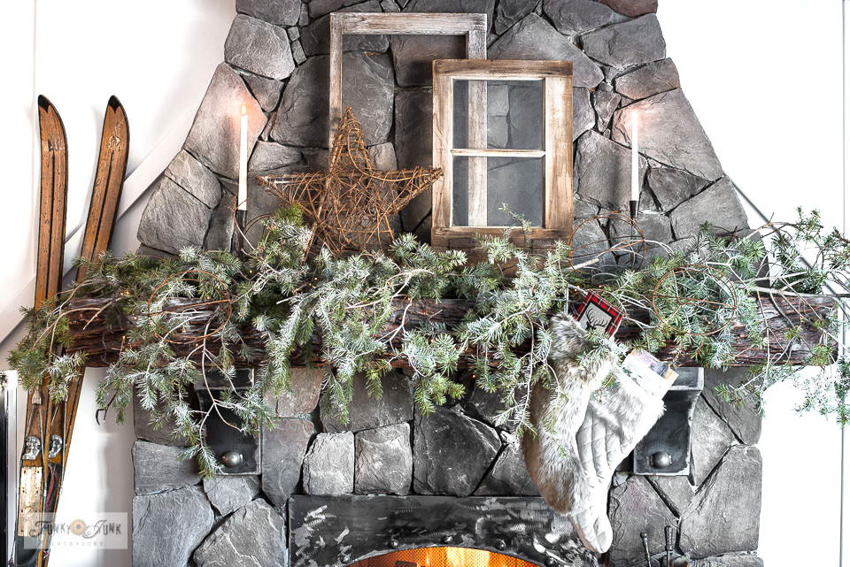 Christmas mantel with rustic evergreen branches and vintage windows, part of a Christmas living room home tour! Click to tutorials and full tour!