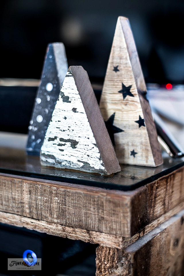 Scrap wood Christmas trees by TV in a Christmas living room home tour. Click to learn how to make them!